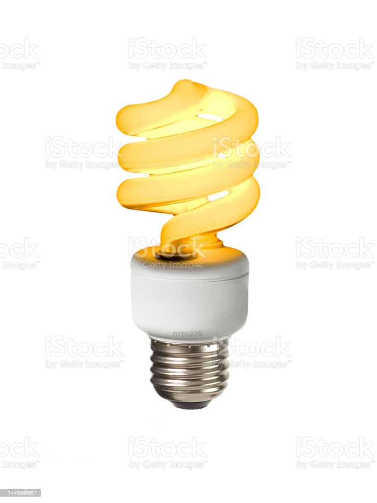 Glowing compact fluorescent on white. stock photo