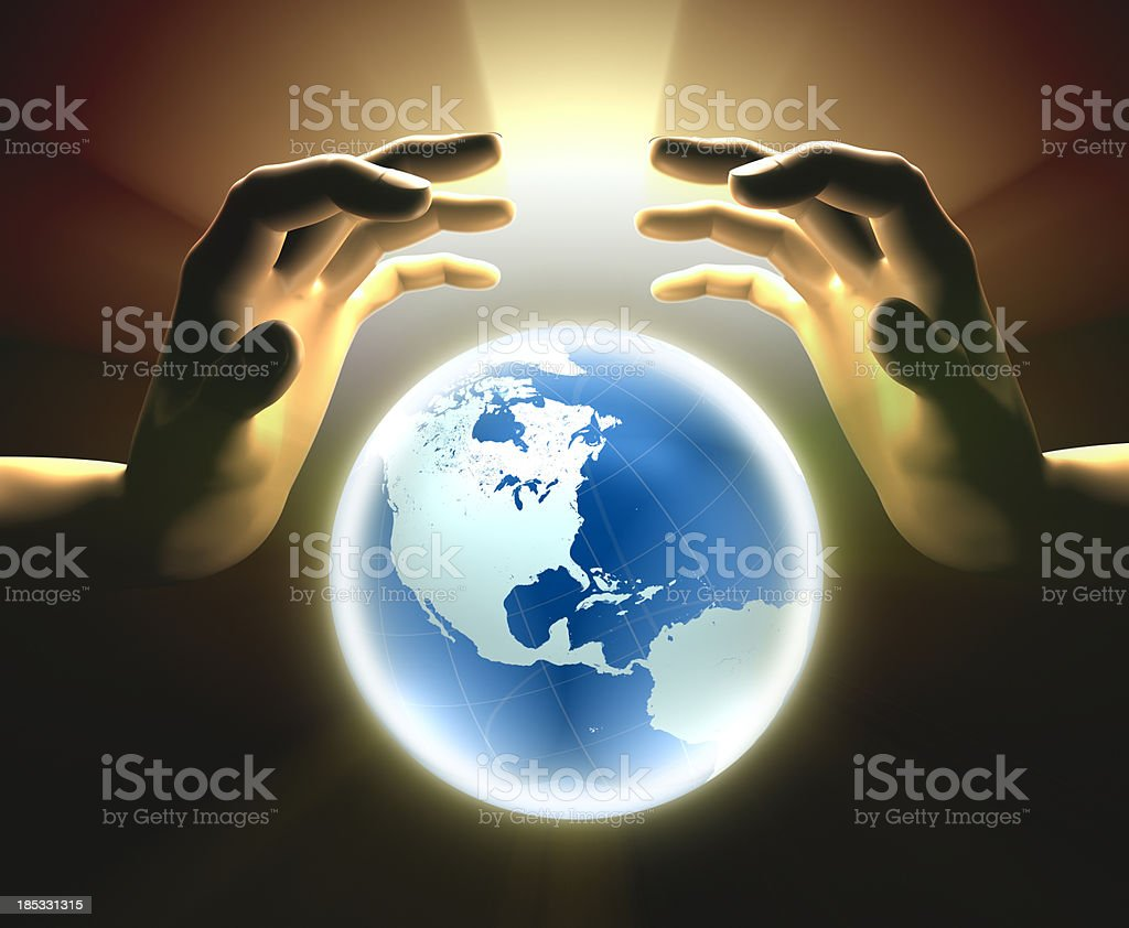 Glowing Earth with hands stock photo