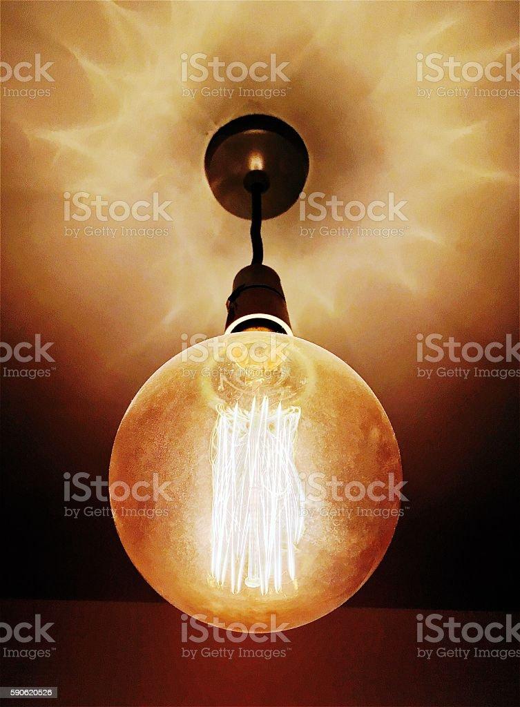 Glowing Edison filament light bulb stock photo