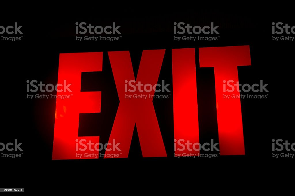 Glowing electric exit sign stock photo
