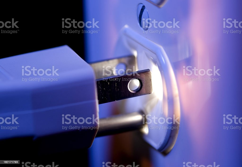 Glowing Electric Outlet and Plug stock photo