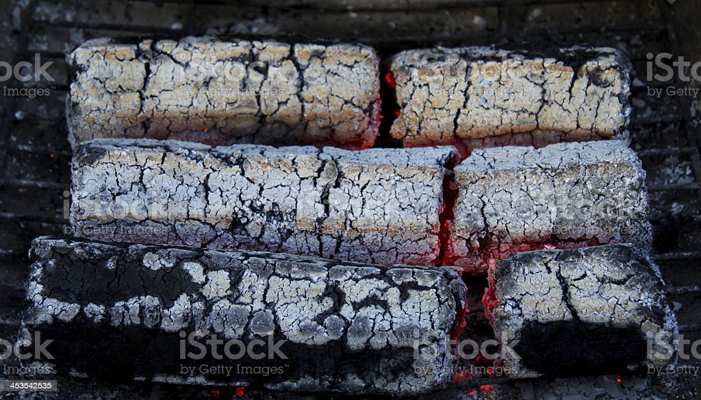 glowing embers from wooden briquettes royalty-free stock photo