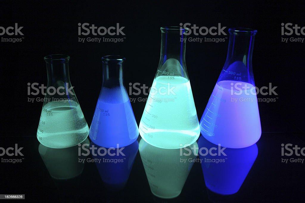 Glowing Erlenmeyer Flasks stock photo