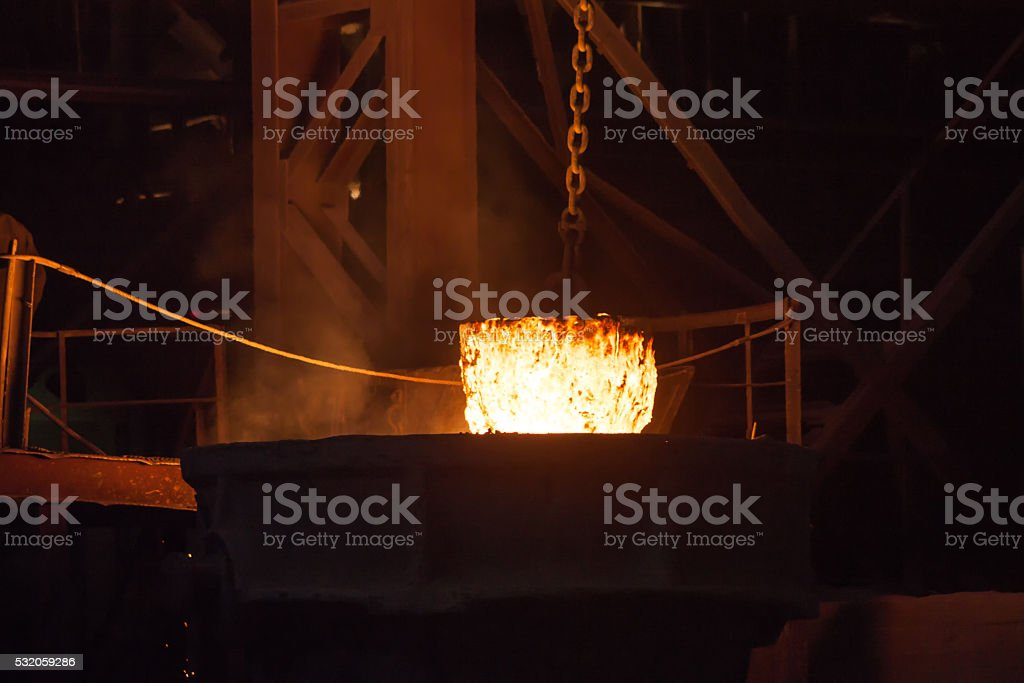 Glowing ferroalloy in a metallurgical plant royalty-free stock photo