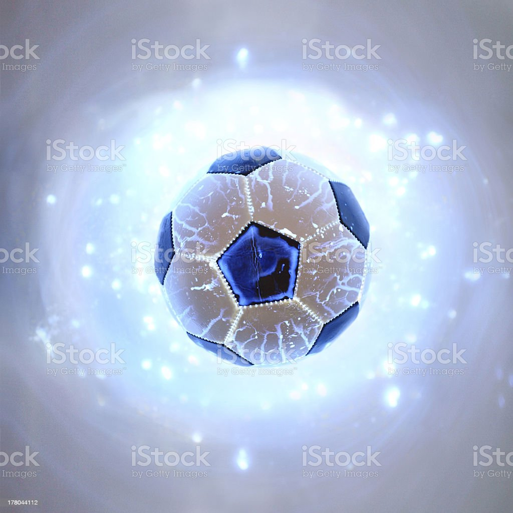 Glowing football ball on blue background stock photo
