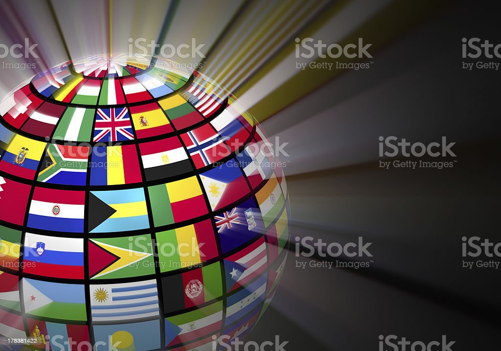 Glowing globe with world flags on black background stock photo