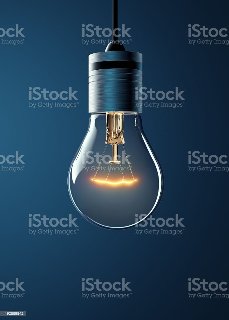 Glowing Hanging Light Bulb stock photo