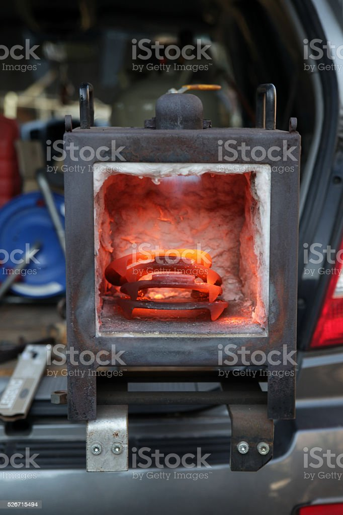 Glowing horseshoes in blacksmith oven stock photo