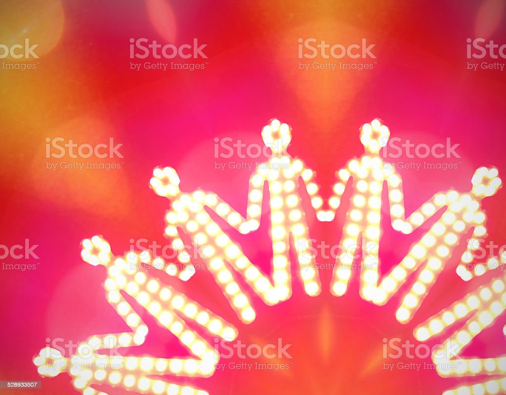 glowing iconic human silhouettes holding their hands stock photo