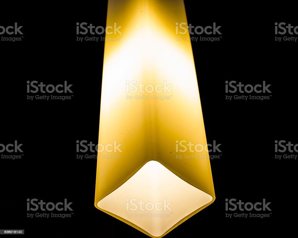 Glowing lamp on black background stock photo