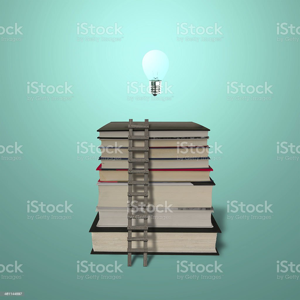 Glowing lamp on top of stack books with wooden ladde royalty-free stock photo