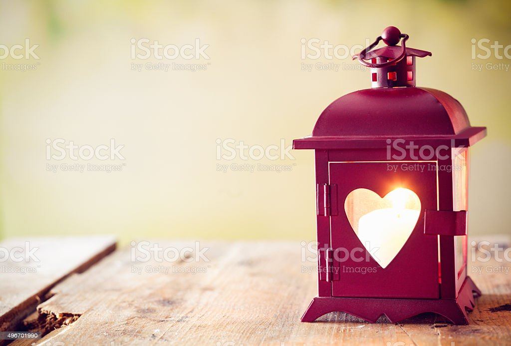 Glowing lantern with a heart stock photo