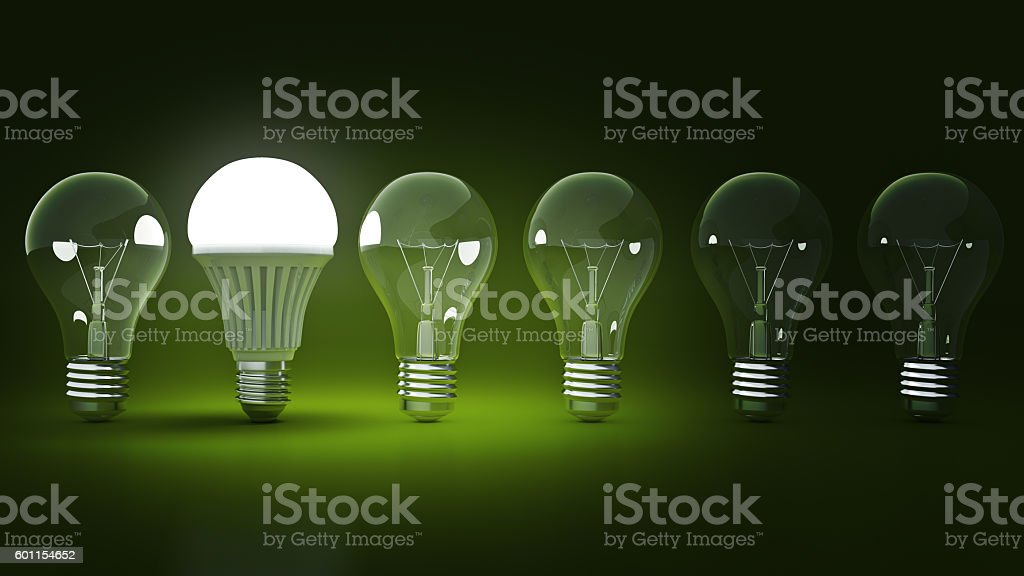 Glowing LED bulb and simple light bulbs. 3d rendering stock photo