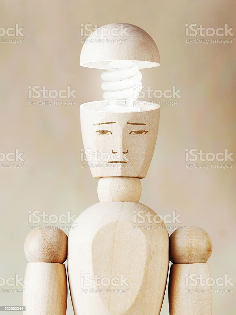 Glowing light bulb in the human head. Concept of genius stock photo