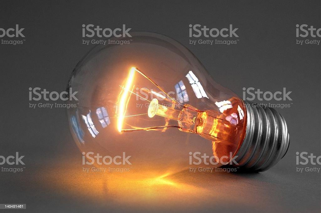 Glowing light bulb stock photo