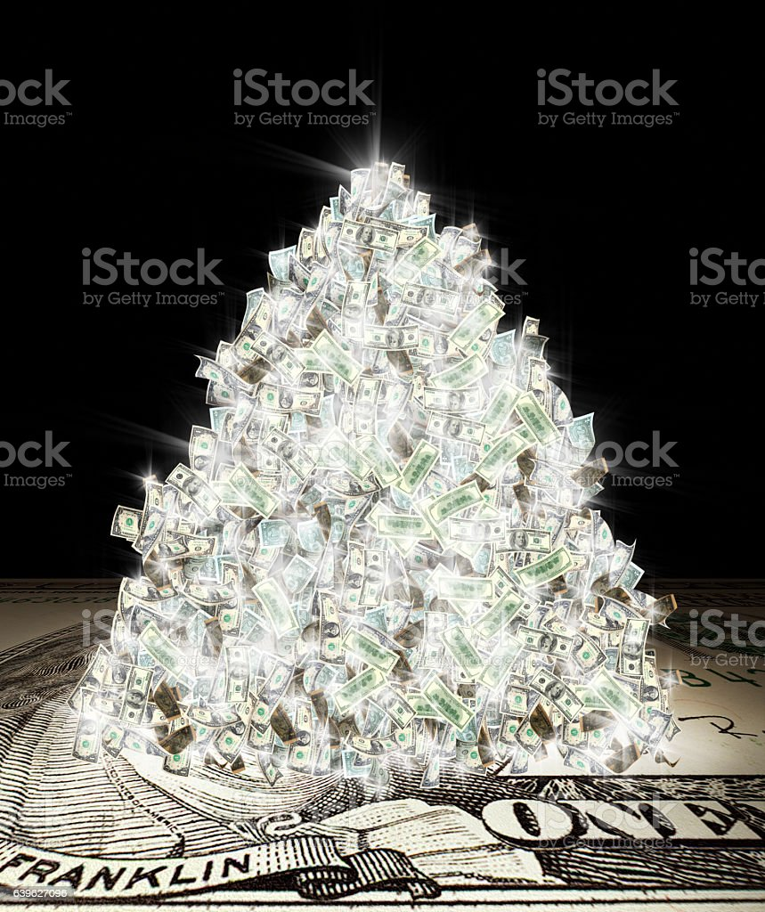 glowing money pile stock photo