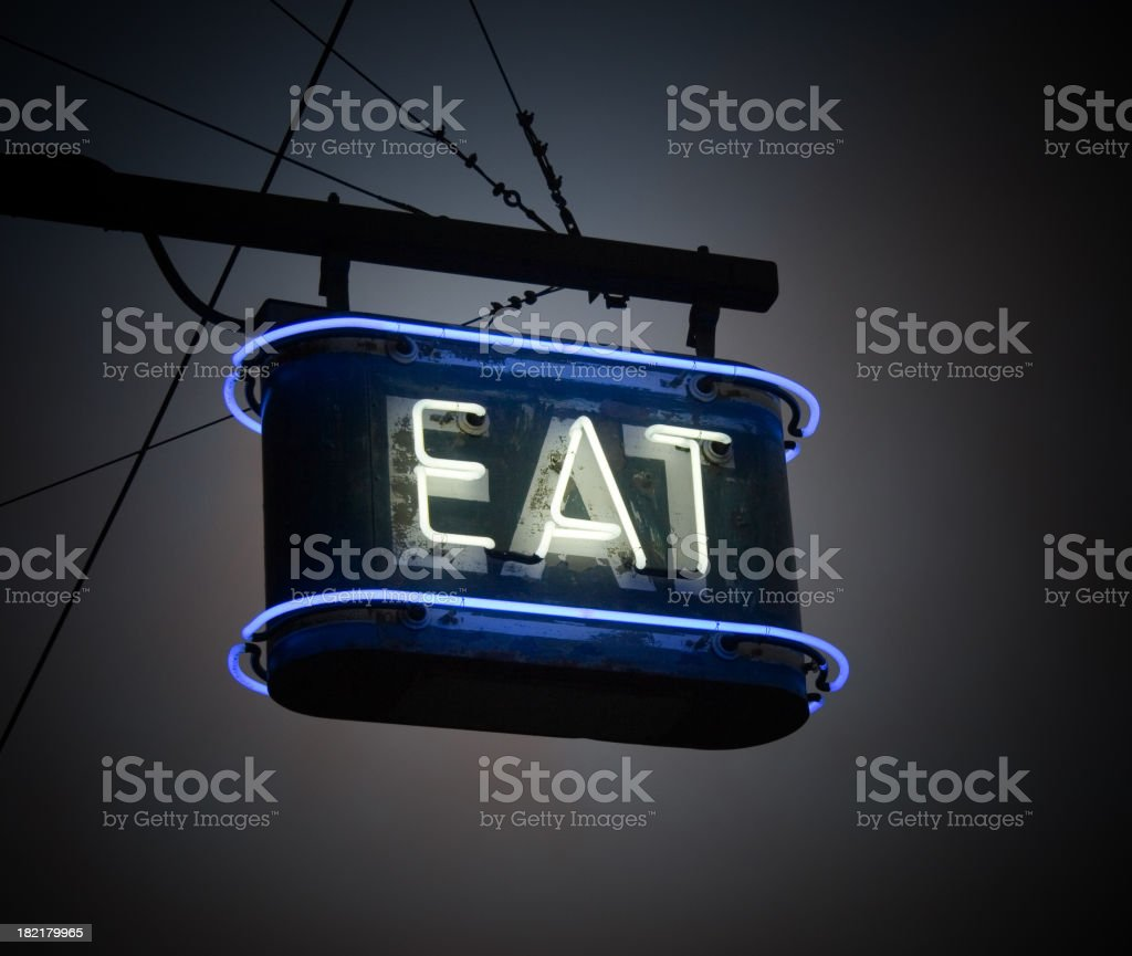 Glowing Neon EAT sign stock photo