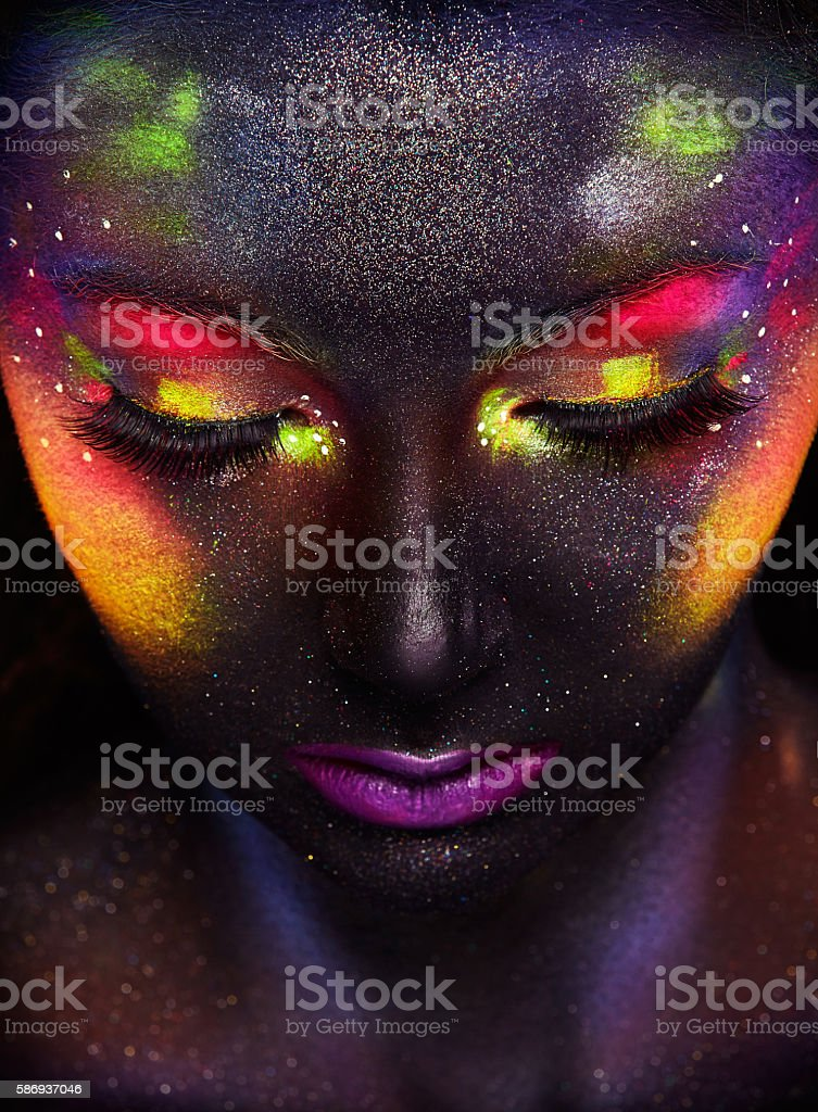 Glowing neon makeup with dramatic look stock photo