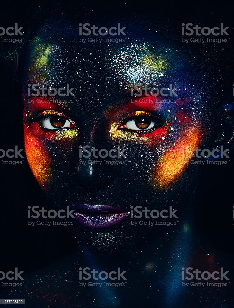 Glowing neon makeup with dramatic look. stock photo