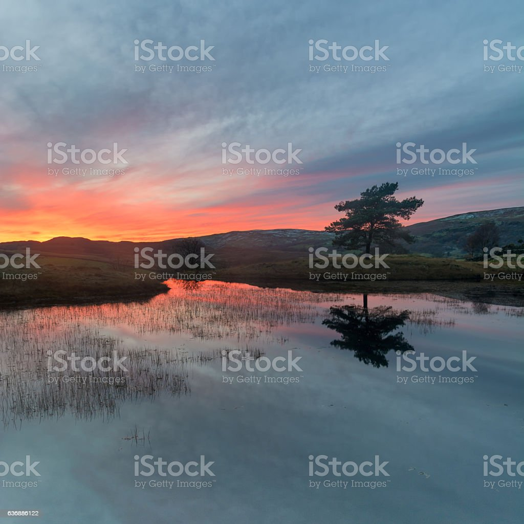 Glowing Orange Lake District Sunset With Reflections. stock photo