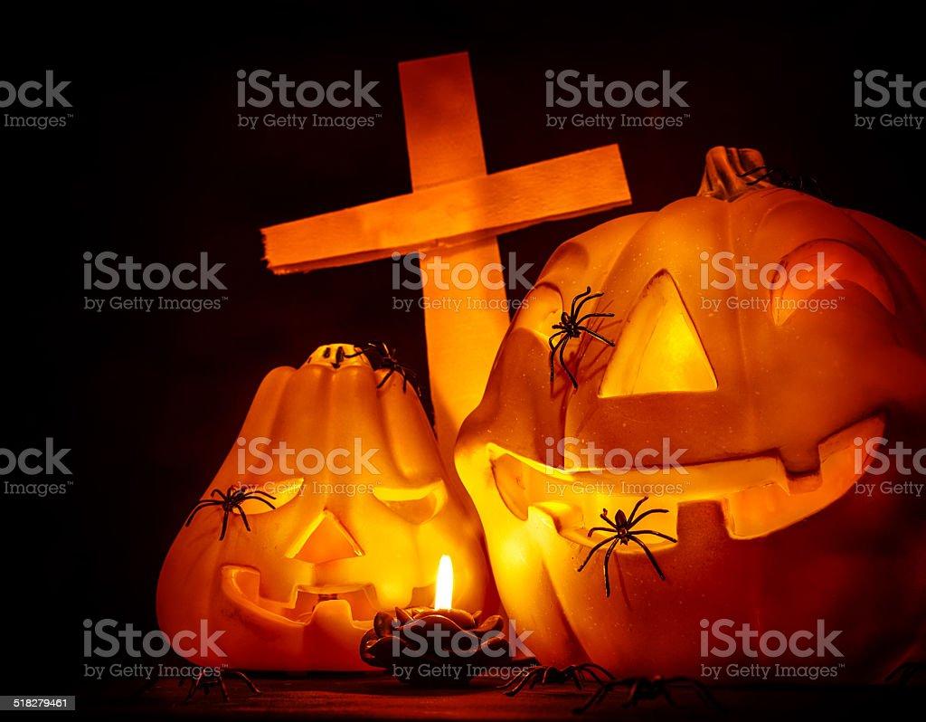 Glowing pumpkin with cross stock photo