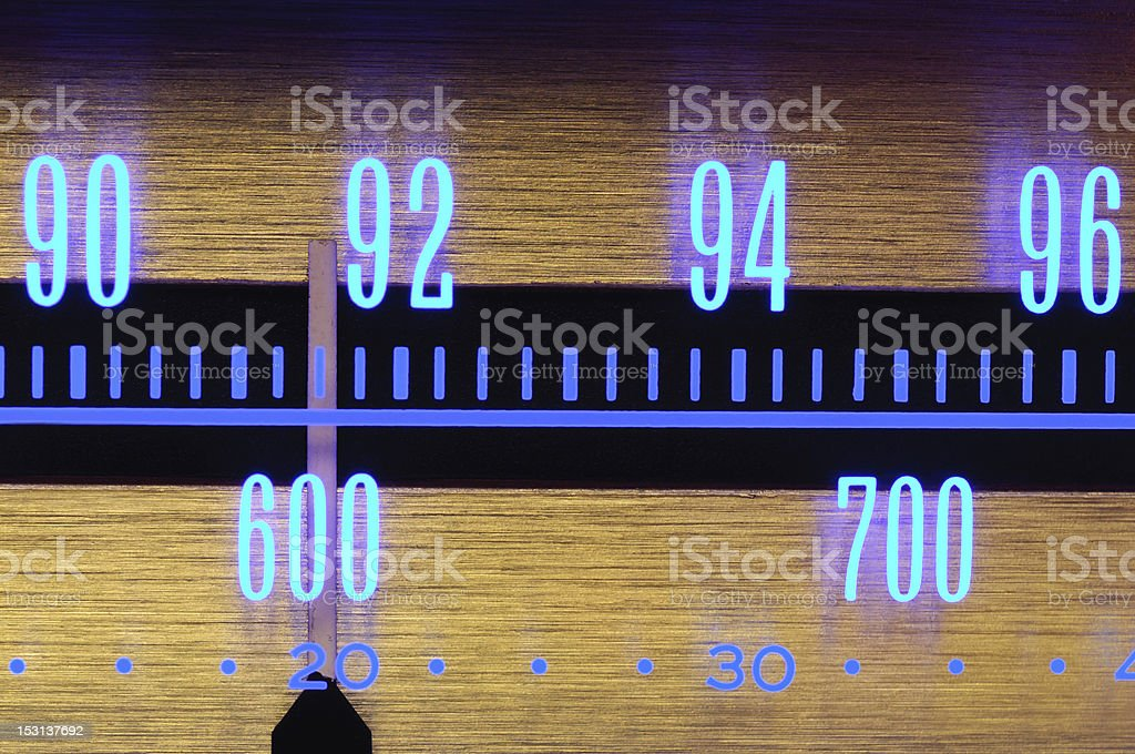 Glowing Radio Dial close-up - 70s classic music player equipment stock photo