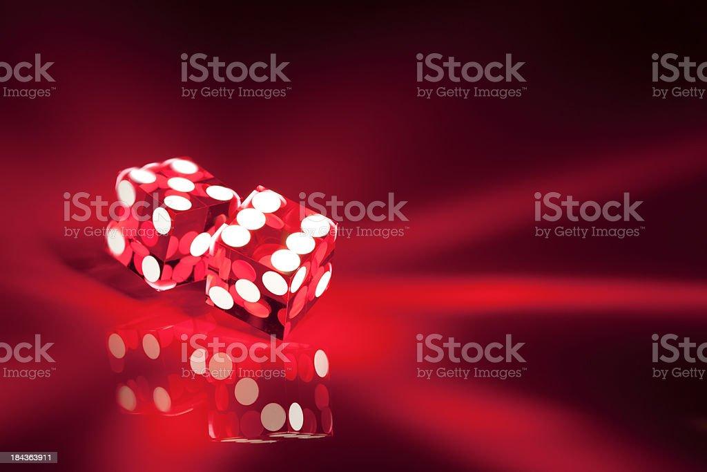 Glowing red acrylic casino dice II stock photo