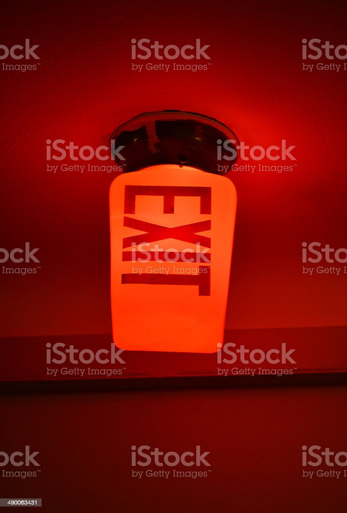 Glowing Red Exit Sign stock photo