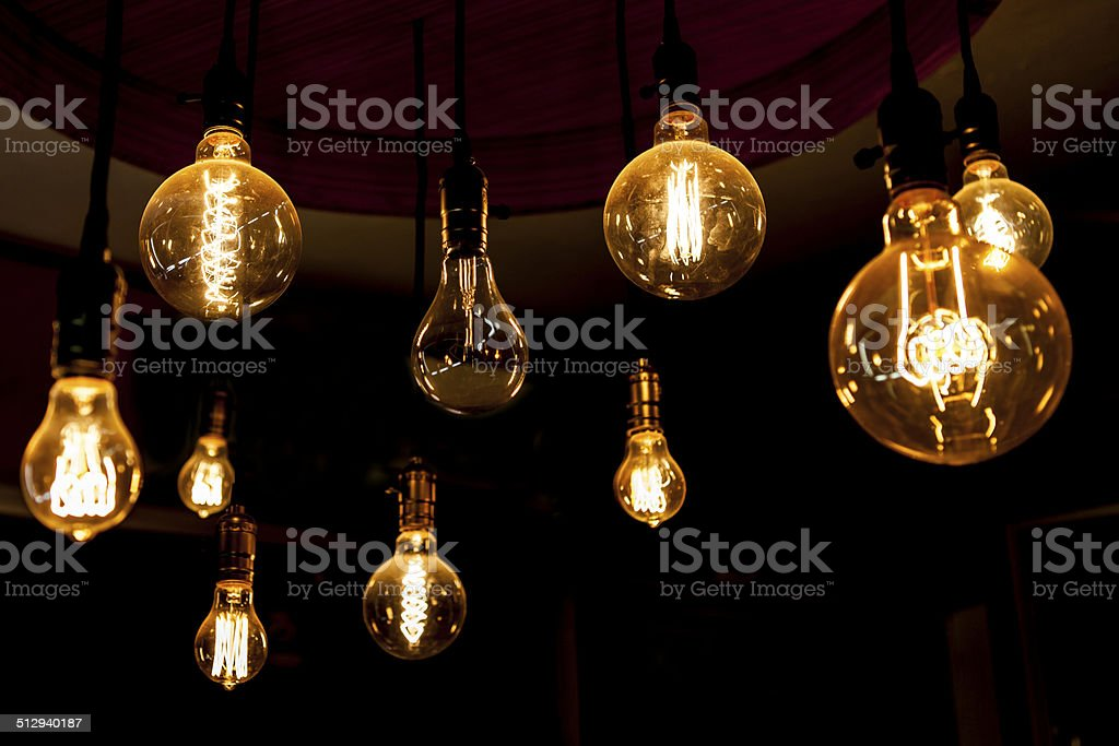 glowing round tungsten lamps, different, blind spot, bad finger stock photo