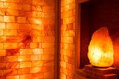 Glowing salt lamp and Himalayan salt bricks
