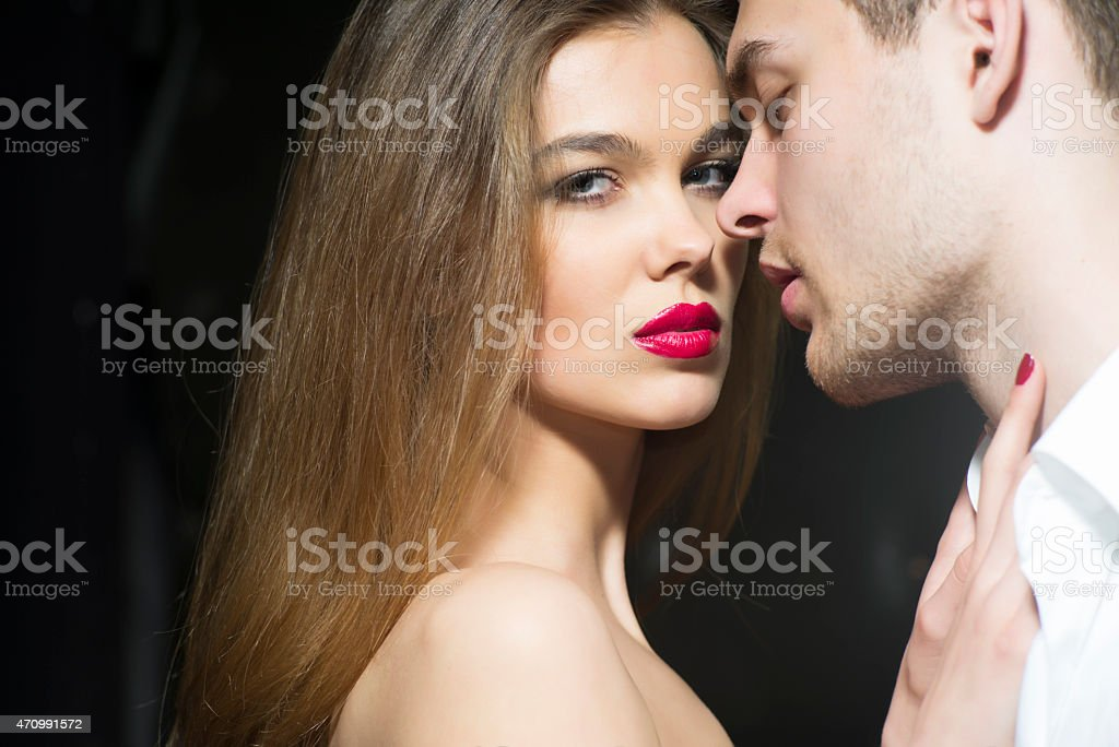 Glowing sexy couple stock photo