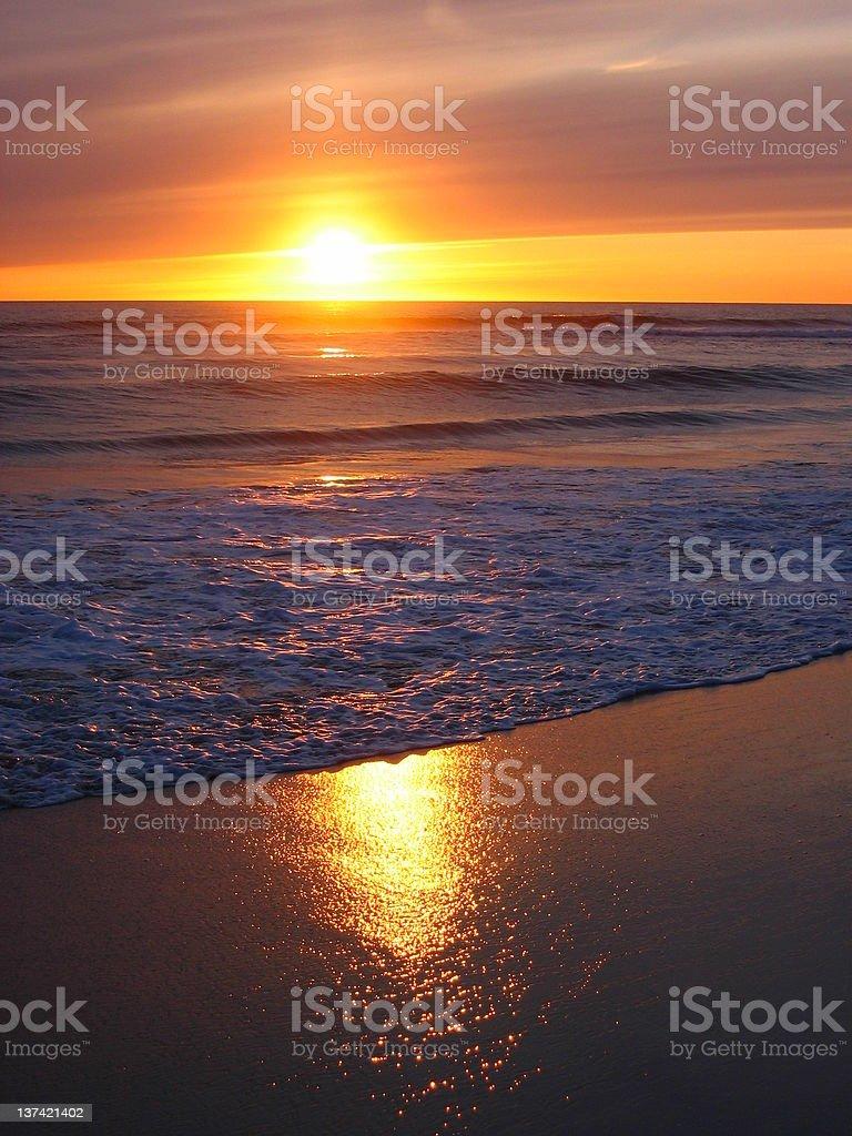 Glowing sunset at beach stock photo
