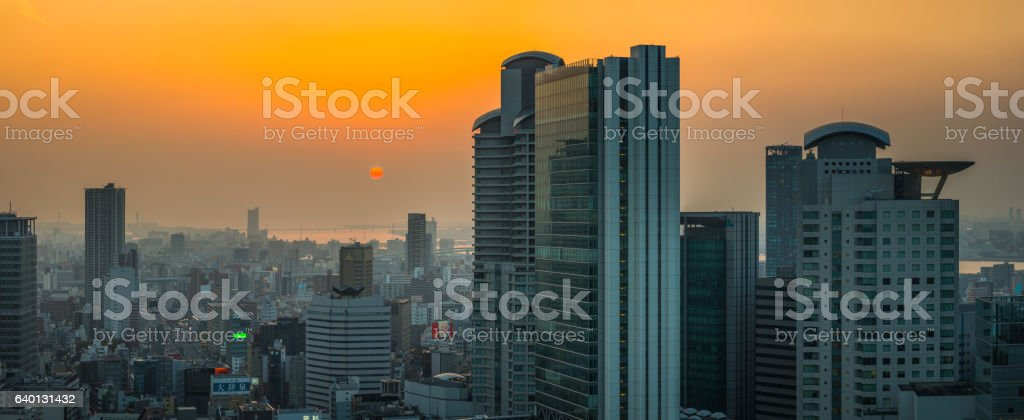 Glowing sunset futuristic highrise skyscrapers crowded cityscape panorama Osaka Japan stock photo