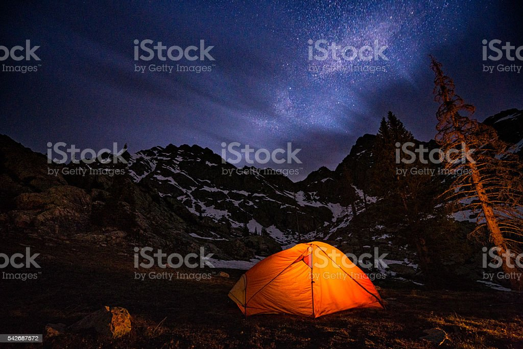 Glowing Tent Backpacking Under the Stars at Night stock photo