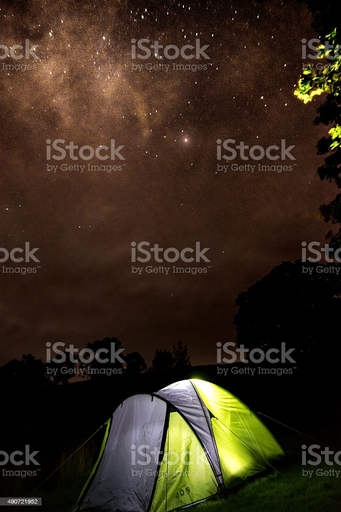 Glowing tent under glowing stars royalty-free stock photo