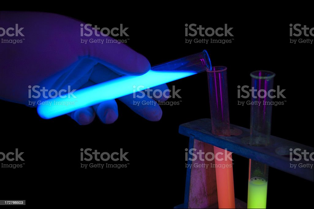 Glowing Test Tubes - Pouring Blue royalty-free stock photo
