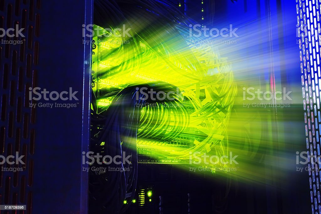glowing thread cables in the disk storage supercomputer data center stock photo