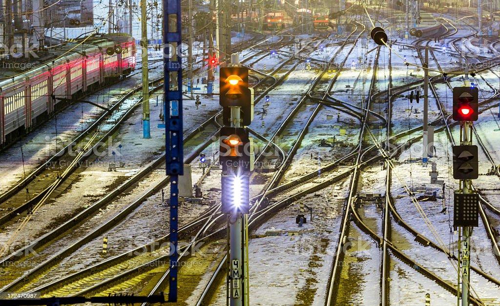 Glowing traffic light at railroad tracks royalty-free stock photo