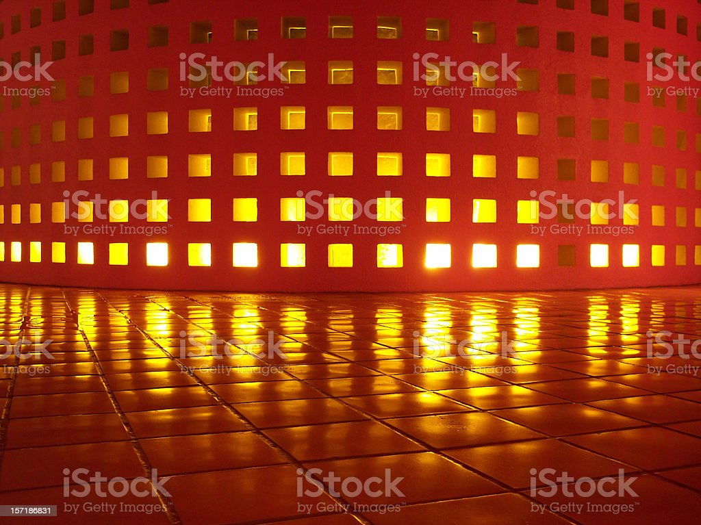 Glowing Wall Reflected on Smooth Saltillo Tile stock photo