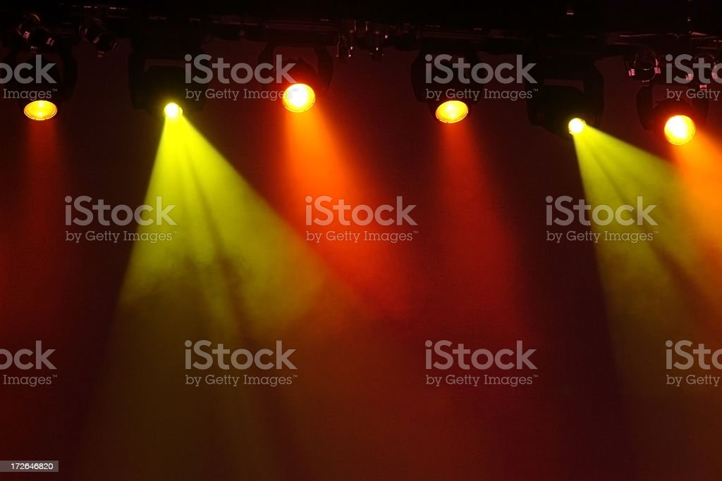 Glowing Yellow and Orange Stage Lights with Dark Background royalty-free stock photo
