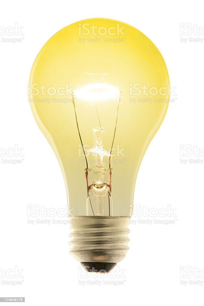 Glowing Yellow Incandescent Light Bulb. Isolated on White with Path royalty-free stock photo