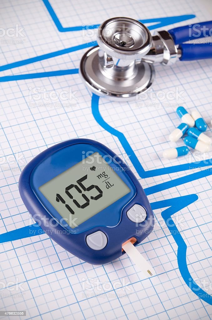 Glucometer and stethoscope on medical background stock photo