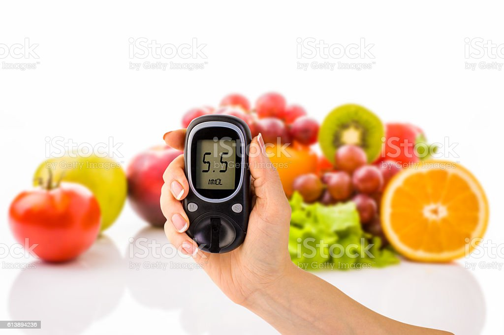 glucometer for glucose level and healthy organic food on a stock photo