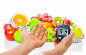 glucometer for glucose level and healthy organic food on a