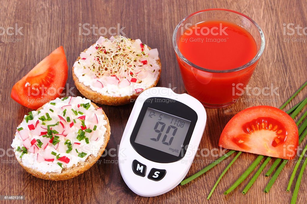 Glucometer, freshly sandwich with cottage cheese and vegetables, tomato juice stock photo