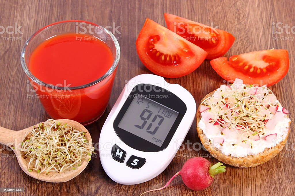 Glucometer, freshly sandwich with vegetables, tomato juice, healthy nutrition stock photo