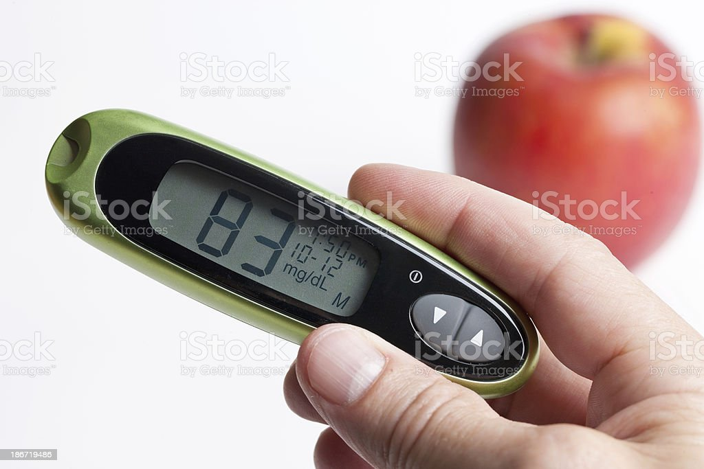 Glucometer with Normal Blood Glucose Level and Apple royalty-free stock photo