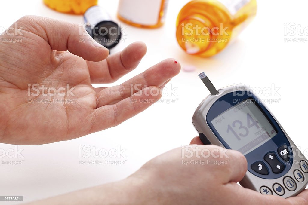 A glucose level blood test meter for diabetes  royalty-free stock photo