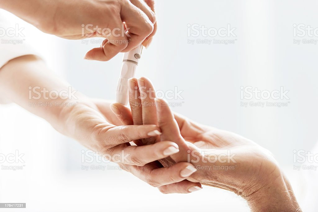 Glucose level blood test. stock photo