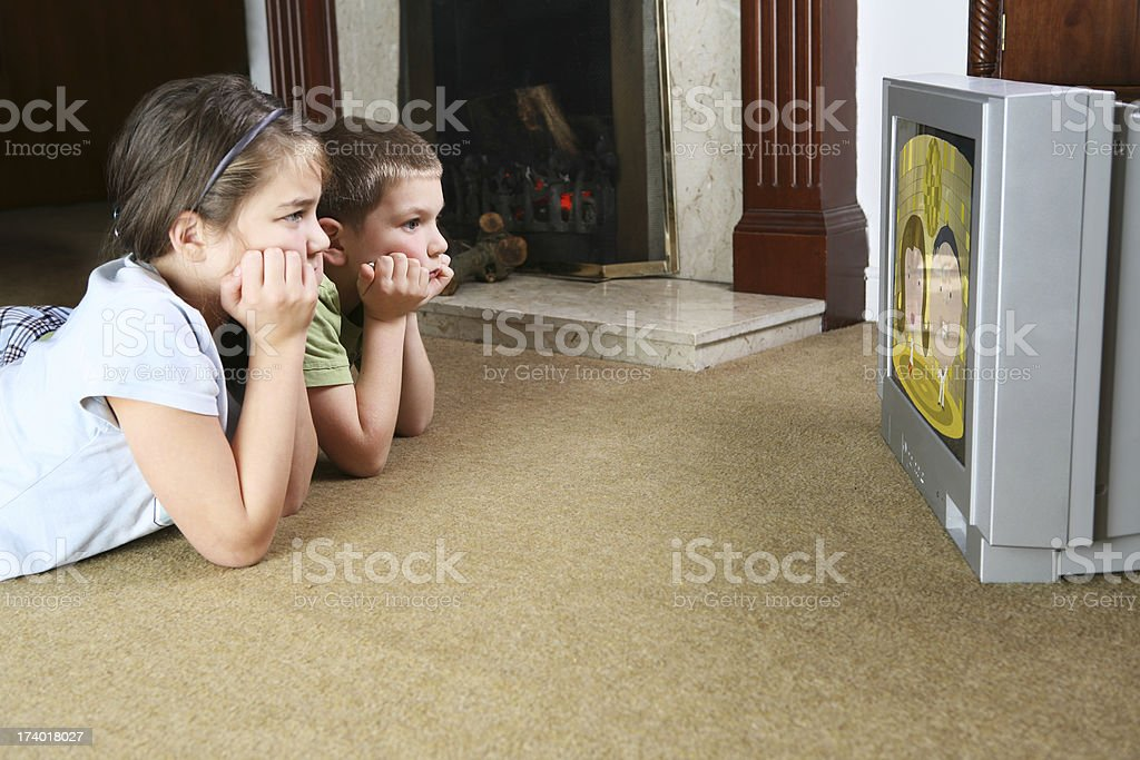 glued to the telly stock photo